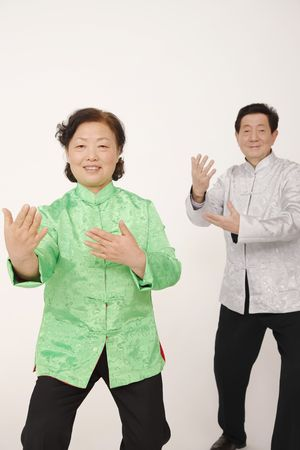 Senior man and woman doing Tai Chi