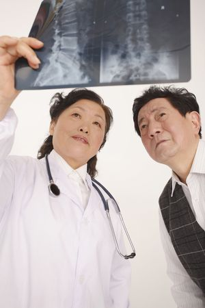 Doctor showing patient his x-ray photo