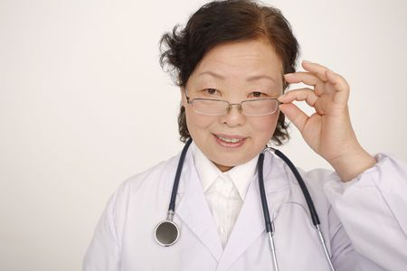 Doctor with glasses looking at camera photo