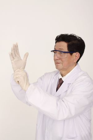 Doctor wearing surgical gloves photo