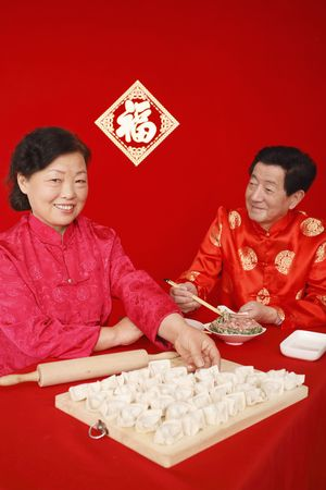 Senior man and woman making chinese dumplings Stock Photo - 4810527