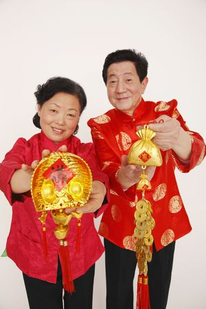 Senior man and woman holding chinese decorations photo