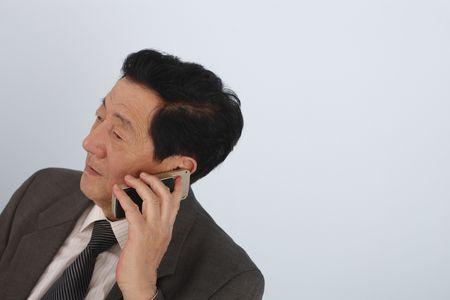 Senior man talking on the phone photo