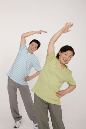 Senior man and woman exercising Stock Photo - 4810405