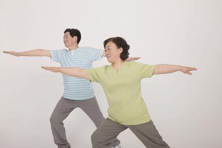 Senior man and woman exercising Stock Photo