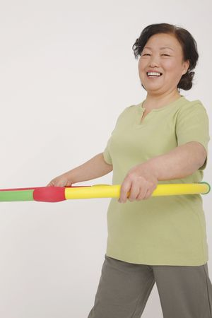 Senior woman using hula hoop
