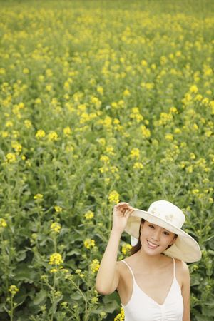 Woman with hat smiling photo