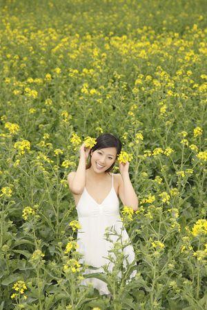 oilseed: Woman decorating oilseed rape on her hair