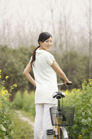 Woman walking with bicycle photo