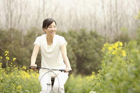 Woman cycling photo