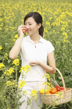 adult rape: Woman smelling a red apple Stock Photo