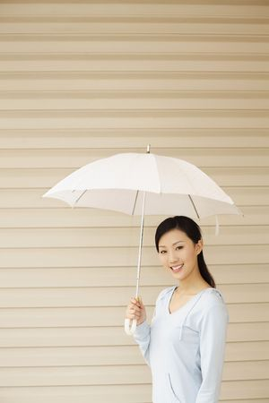 Woman holding a white umbrella