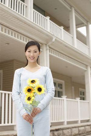 Woman holding sunflower photo