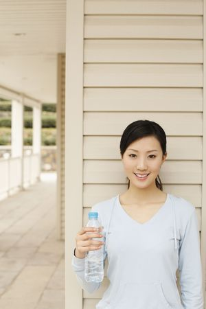Woman holding a bottle of water photo