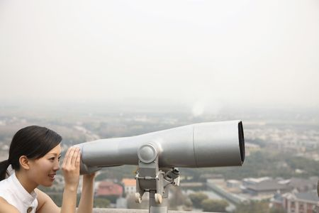 Woman looking through telescope Stock Photo - 4810446