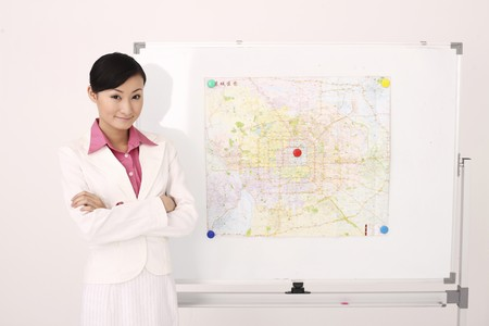 Businesswoman standing next to map