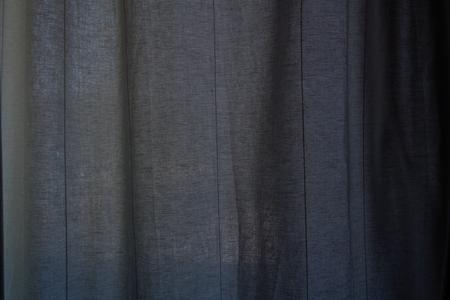 Dark blue linen hangings curtain background