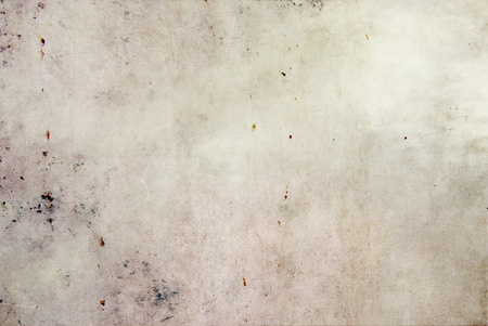 Light textile background with dark stains – woven cotton canvas texture