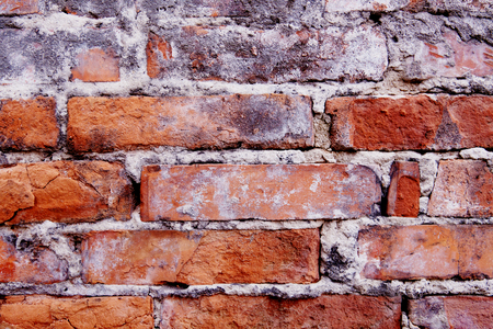 Old wall background of bricks with cracks, fissures, crevices