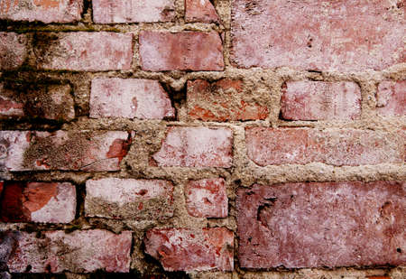 Detail of grunge brick wall background - weathered stone texture with cement