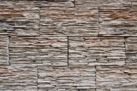 Modern slate stone wall tiling background detail