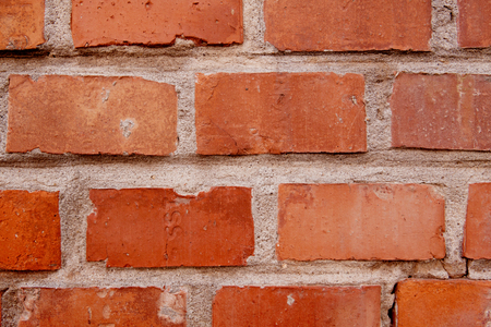 Old red bricks wall background detail