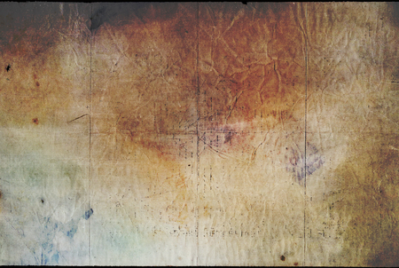 Dark old paper texture yellowed paper background with stains