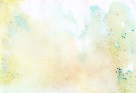 Light blue and green abstract watercolor background with blurred stains and drips