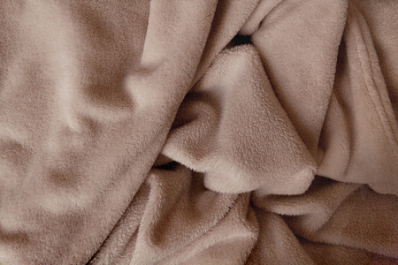 Crumpled soft hairy blanket in light brown color Stok Fotoğraf