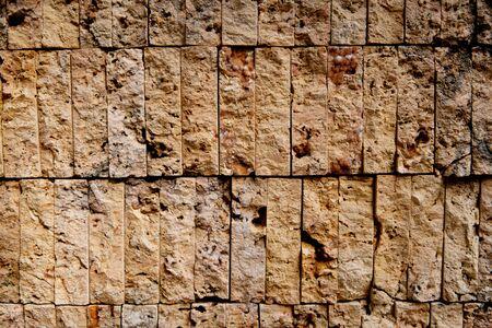 Decorative masonry from stone bricks in yellow color 写真素材