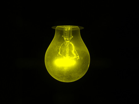 incandescent: Yellow incandescent bulb
