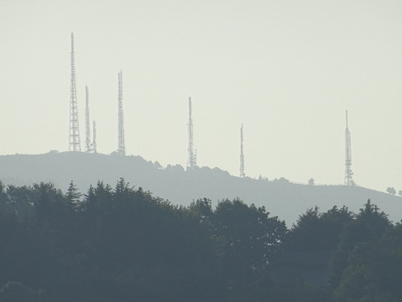 Range of distant repeaters wrapped in mist