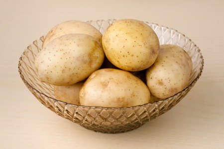 Fresh potatoes in a vase