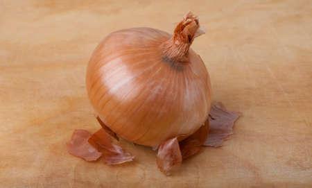 Onion bulb on wooden board