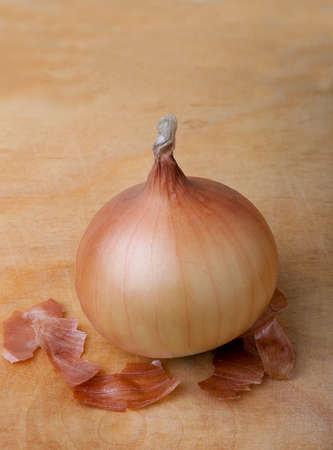 Fresh onion on wooden board