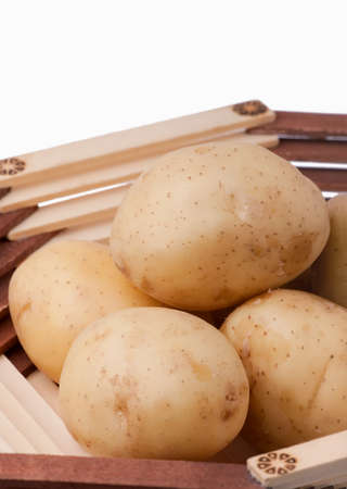 Fresh potatoes in a wooden vase Stock Photo