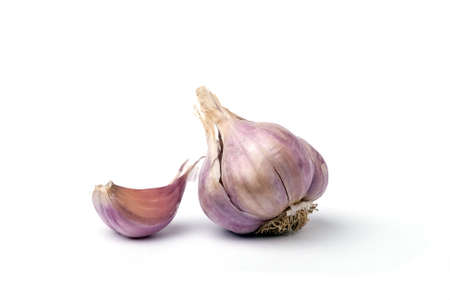Garlic Clove and bulb isolated on white Stock Photo