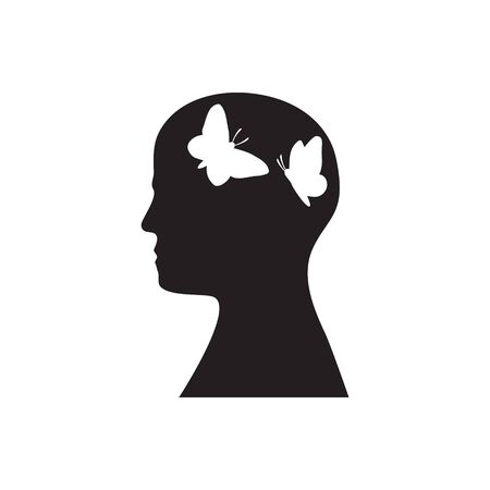 Silhouette of a head with butterflies flying inside on a white isolated background.