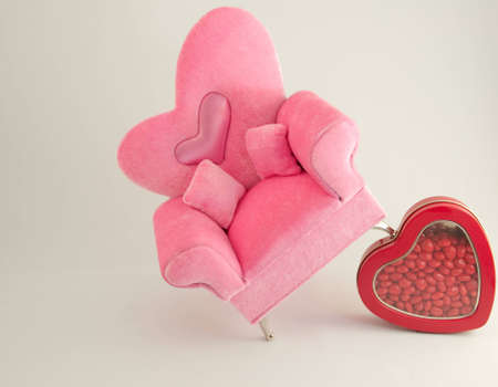 reb: Pink arm chair on a reb box of candy hearts.