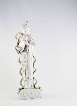 White  hand carved figure on a white background.