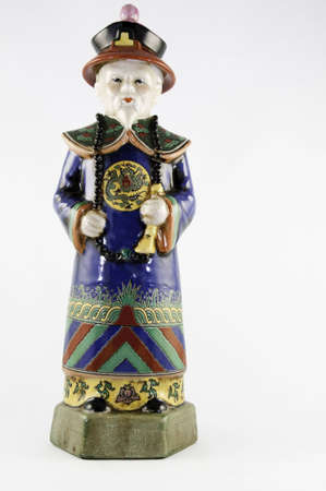 Chinese figurine on a white background. Stock Photo