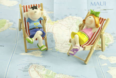 A couple thinking about holidays, It is on a map of Maui.The focus is on the girl with a shallow depth of field. Stockfoto
