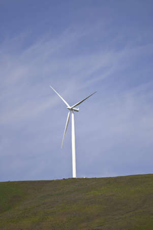 Wind turbine on top of a hill.