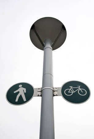 post: Lamps post showing walk and bicycle sign.