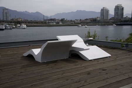 Large lounge chair on seawall walkway by the 2010 winter olympic village.