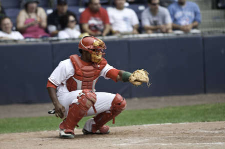 The pitch is across the plate. And the catcher caught the ball you can see the chock dust around his glove.