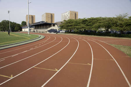 Track and field lanes in a stadium.This is the a turn coming up. Stock Photo