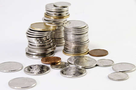 Canadian coins stacked on a white background. photo