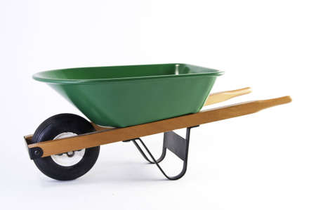 Eye level view of the green wheel barrel.It is on a white background.