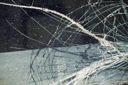 Broken windshield that looks like a spider webb.